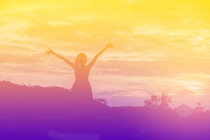 Young woman enjoying beautiful sunset.